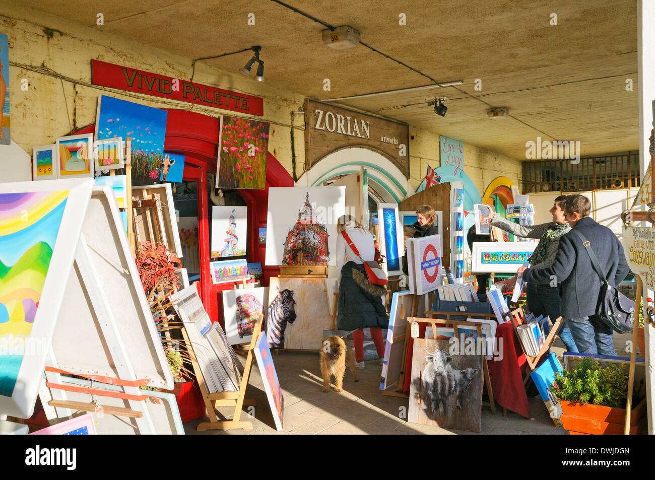 Art for sale outside galleries in The Artists Quarter on Brighton seafront, East Sussex, UK - Stock Image