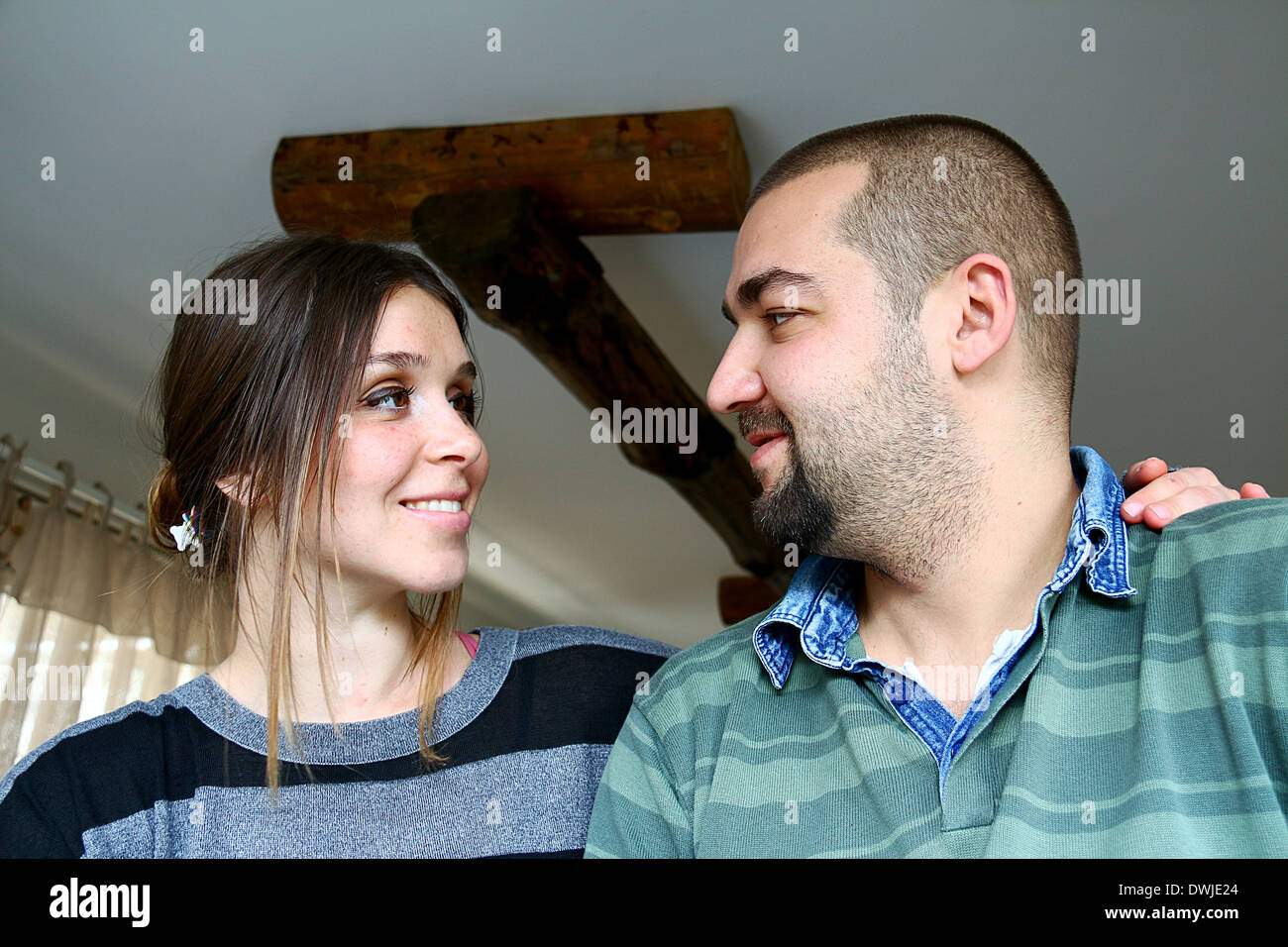 Young Turkish Couple Looking At Each Other Stock Photo
