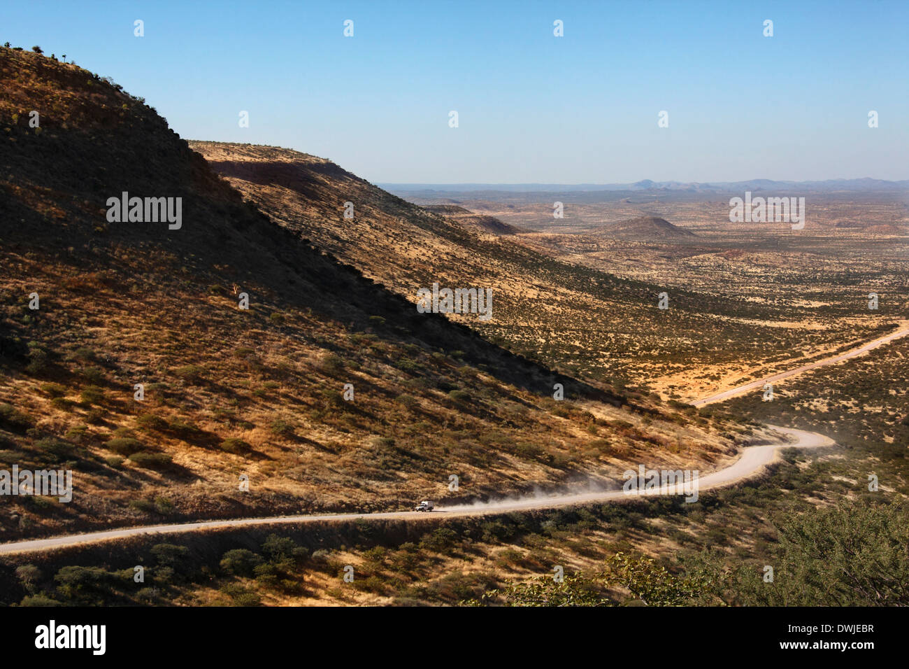 Vehicle on a remote desert road through the Grootberg Pass in the semi-desert of Damaraland in Namibia. - Stock Image