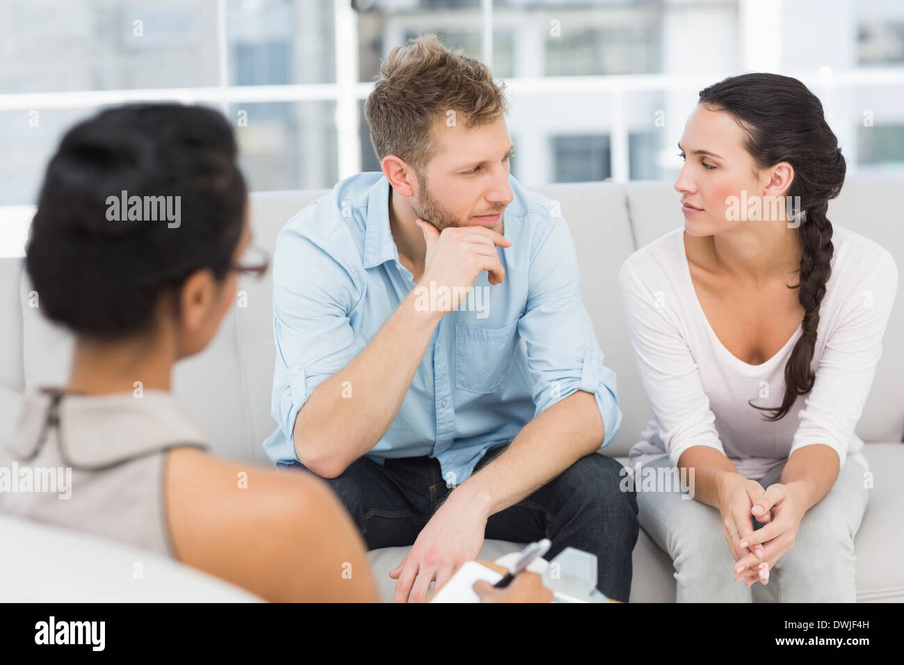 Unhappy couple at therapy session - Stock Image