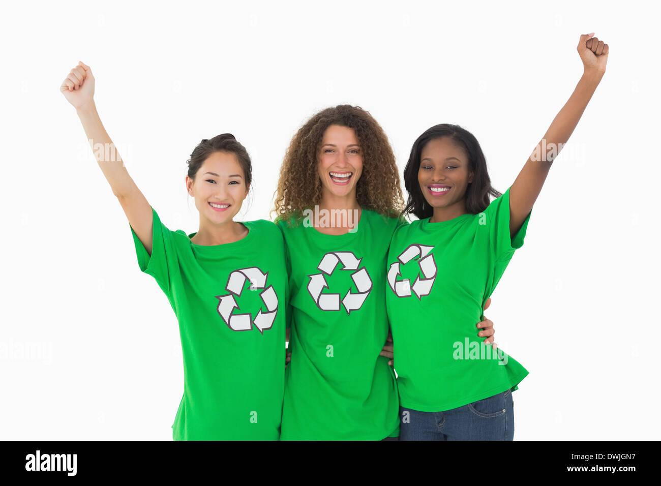 Team of environmental activists cheering at camera - Stock Image