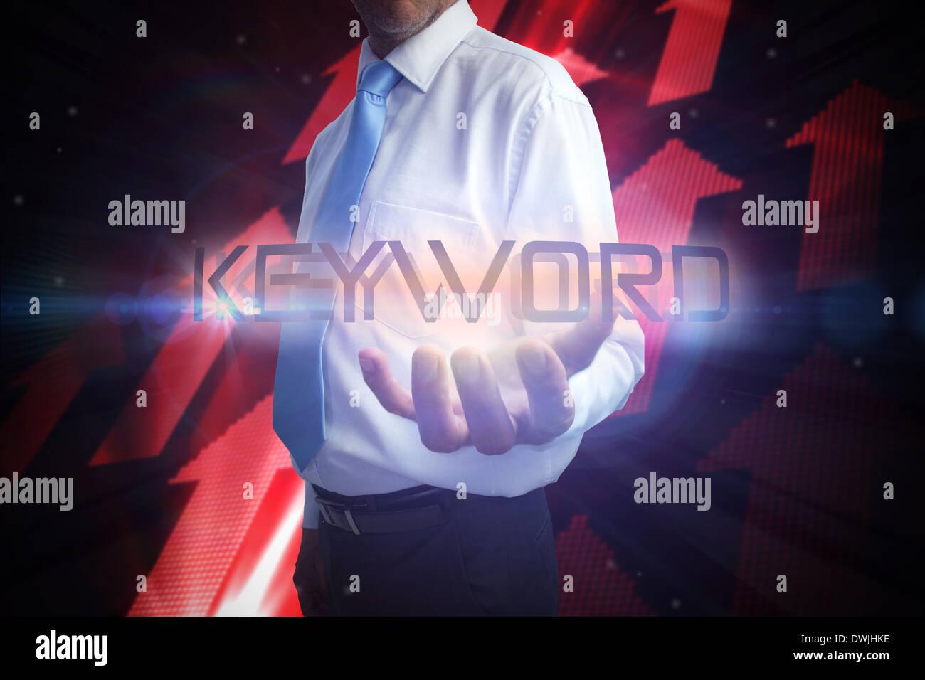 Businessman presenting the word keyword - Stock Image