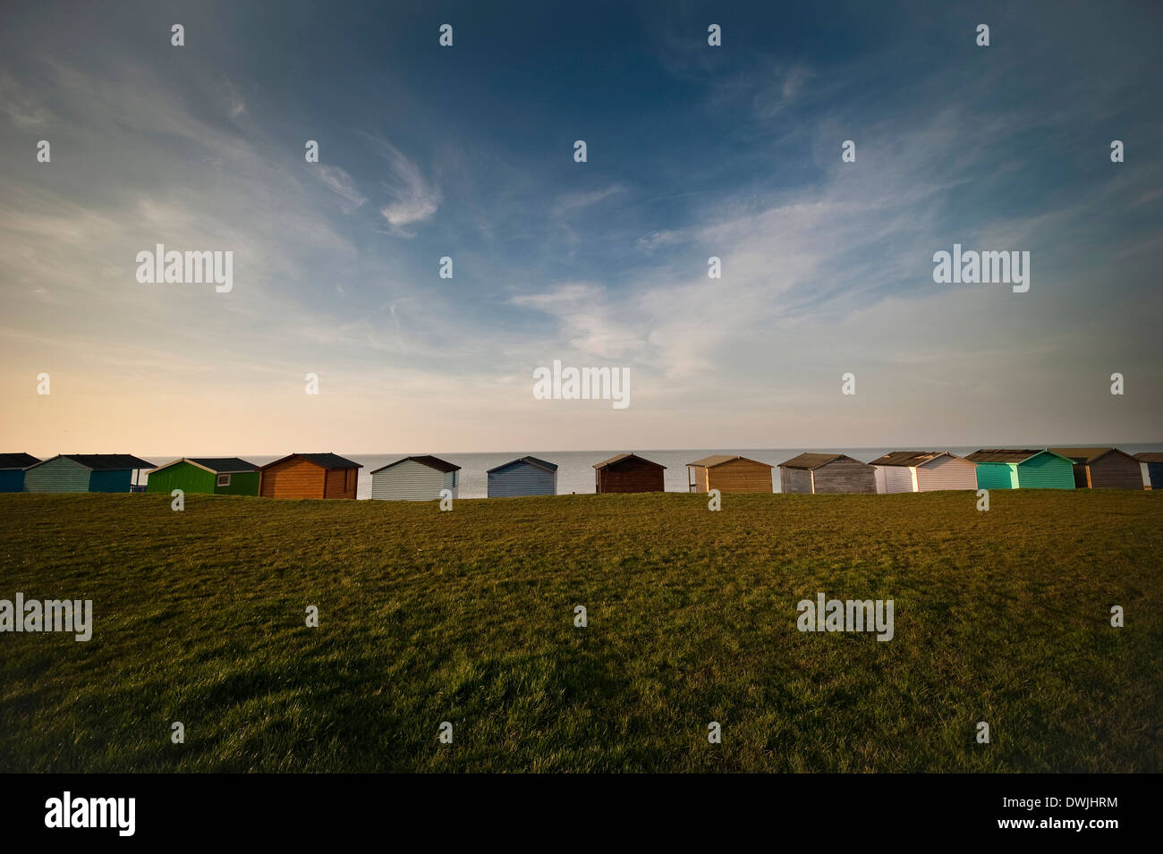 Beach huts overlooking the North Sea at Tankerton near Whitstable, Kent, UK - Stock Image
