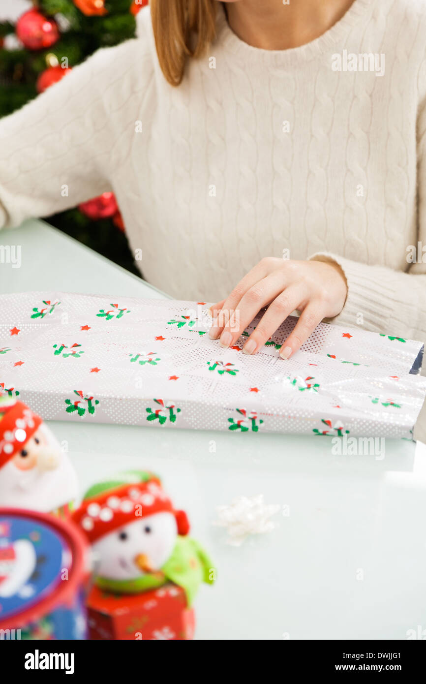 Woman Packing Christmas Present - Stock Image