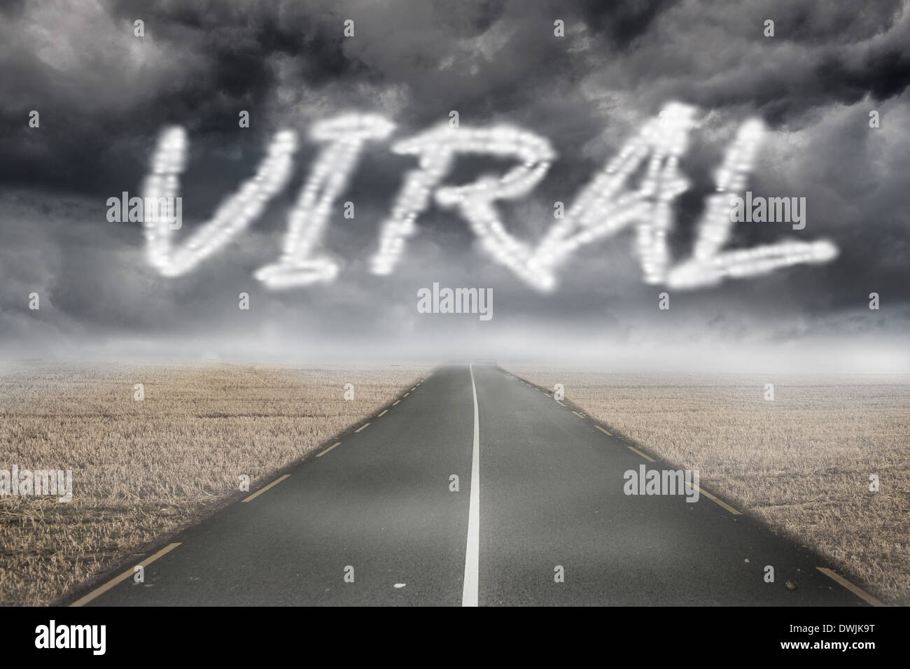 Viral against misty brown landscape with street - Stock Image