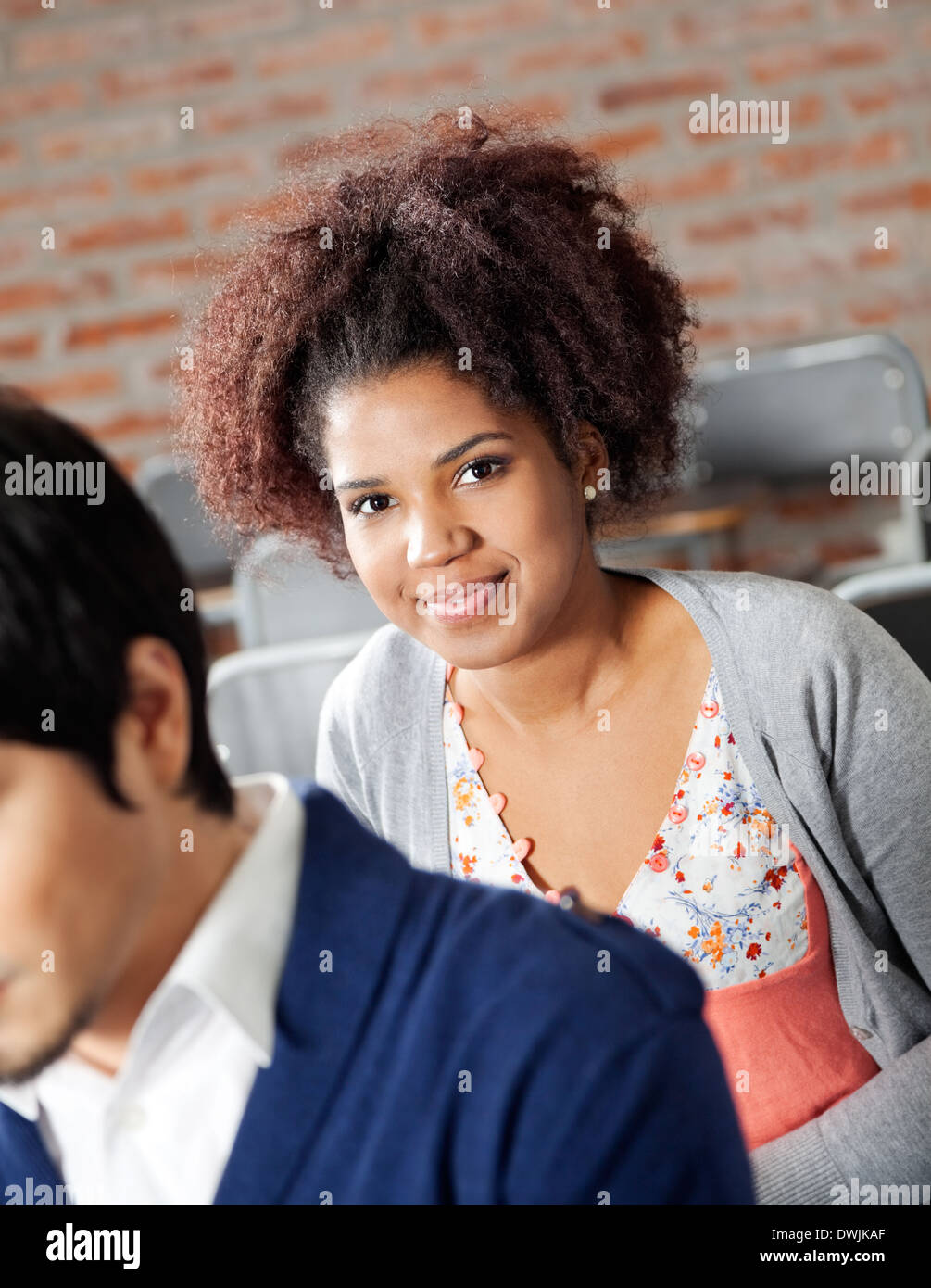 College Student With Classmate In Classroom - Stock Image