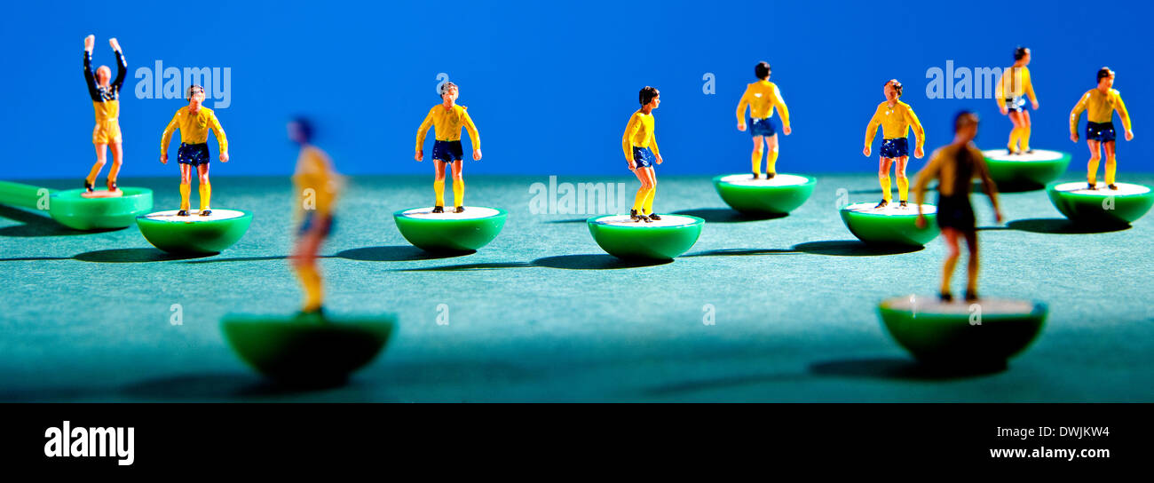 Close up of players in able football game. - Stock Image
