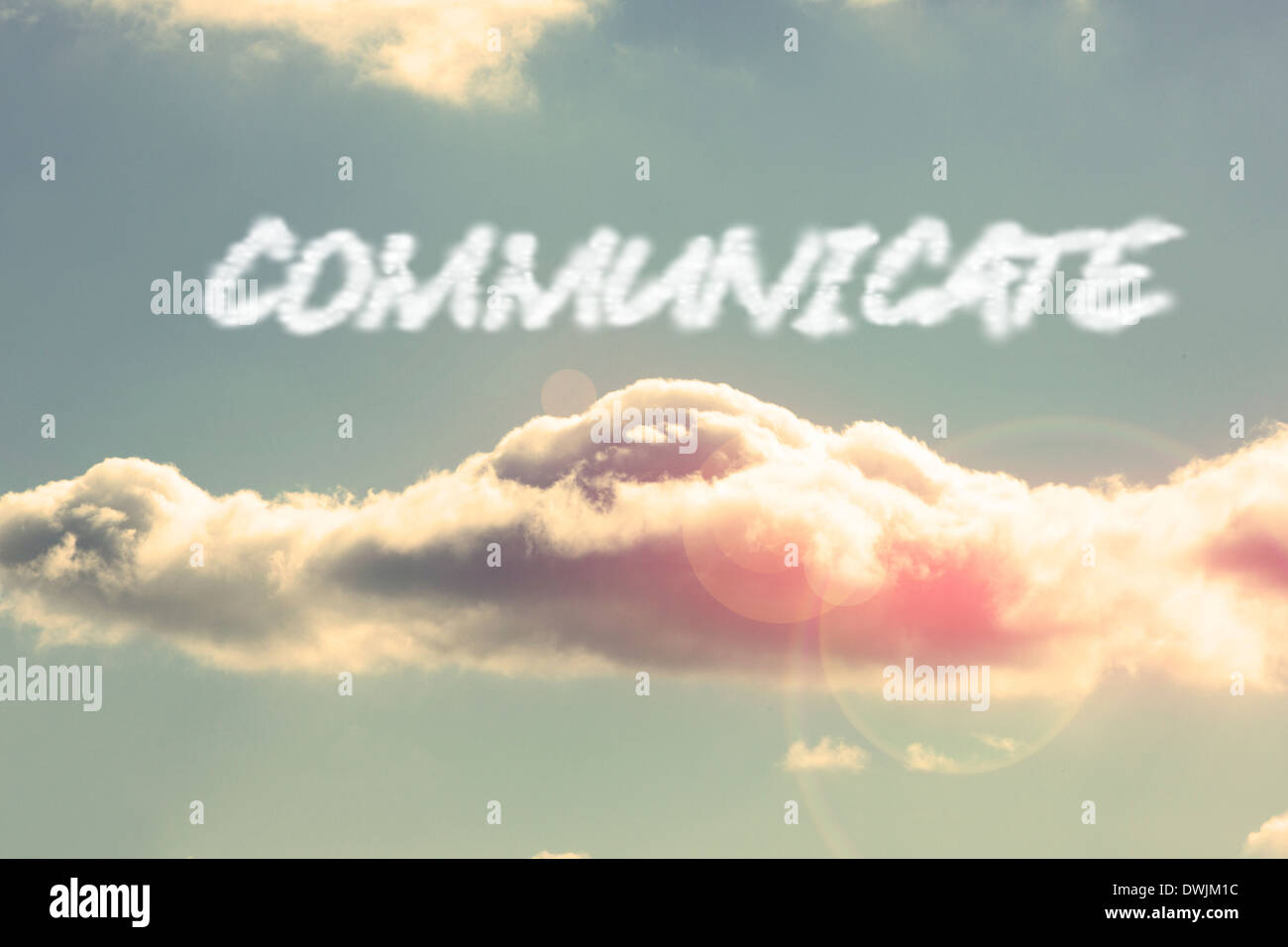 Communicate against bright blue sky with cloud - Stock Image