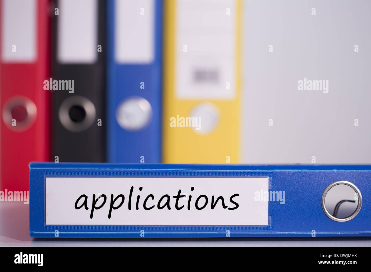Applications on blue business binder - Stock Image