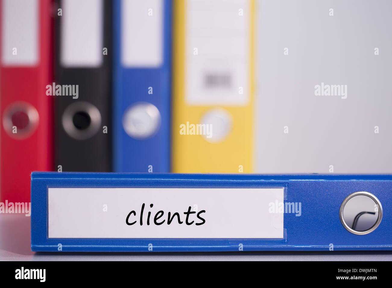 Clients on blue business binder - Stock Image