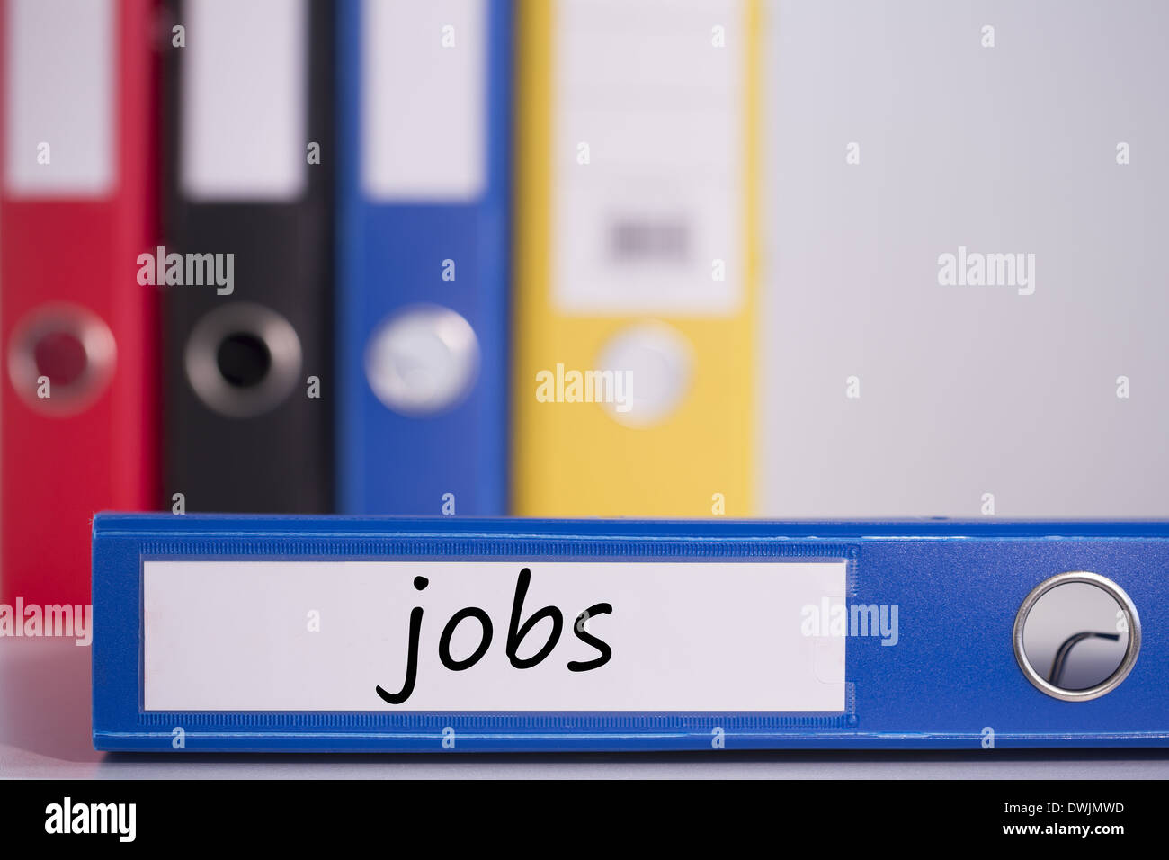 Jobs on blue business binder - Stock Image