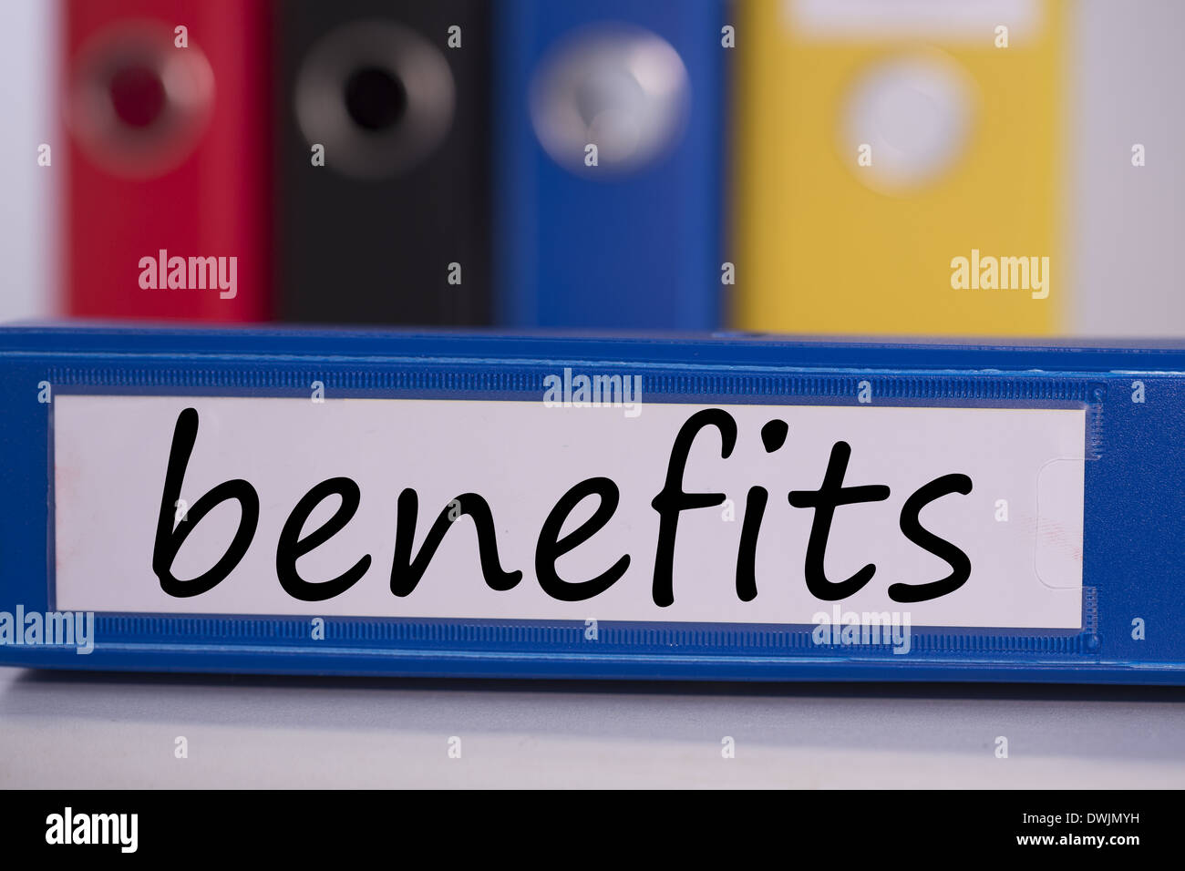 Benefits on blue business binder - Stock Image