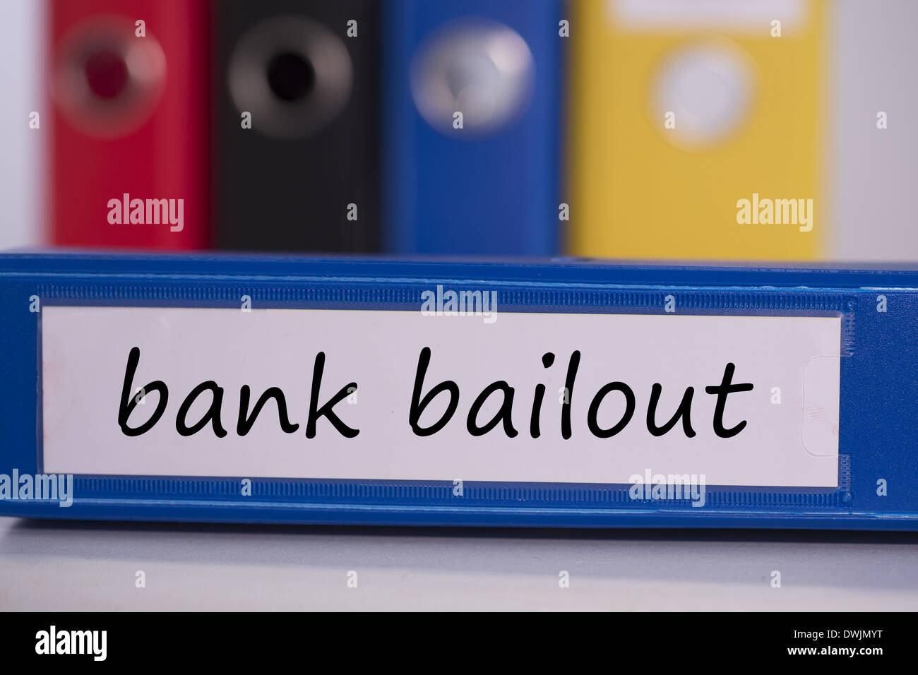 Bank bailout on blue business binder - Stock Image
