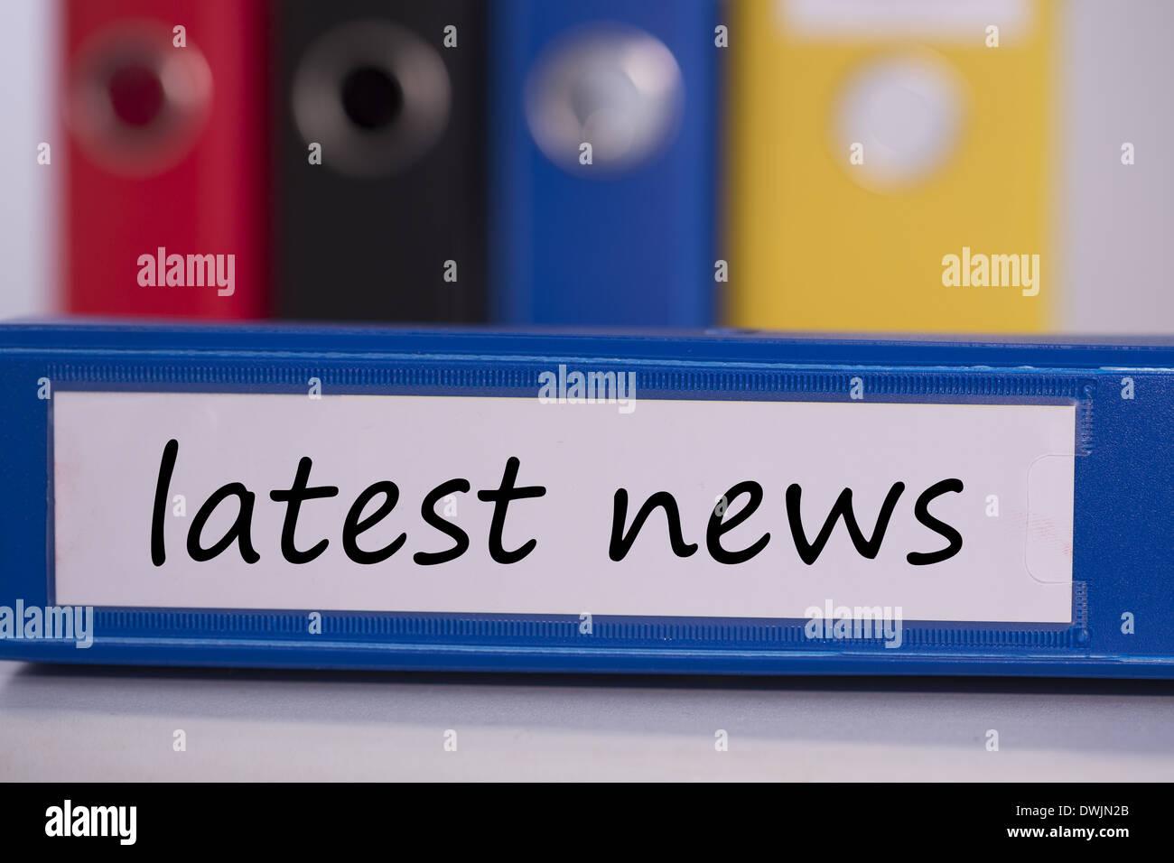 Latest news on blue business binder - Stock Image