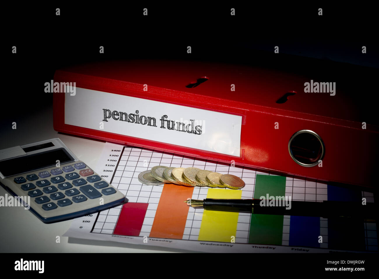 Pension funds on red business binder - Stock Image