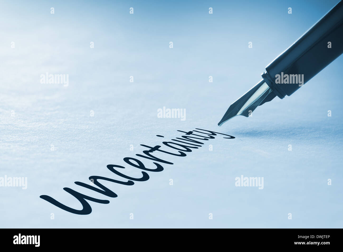 Fountain pen writing Uncertainty - Stock Image