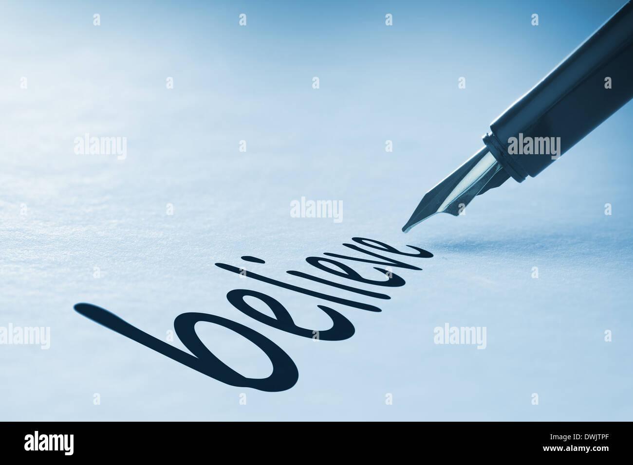 Fountain pen writing Believe - Stock Image