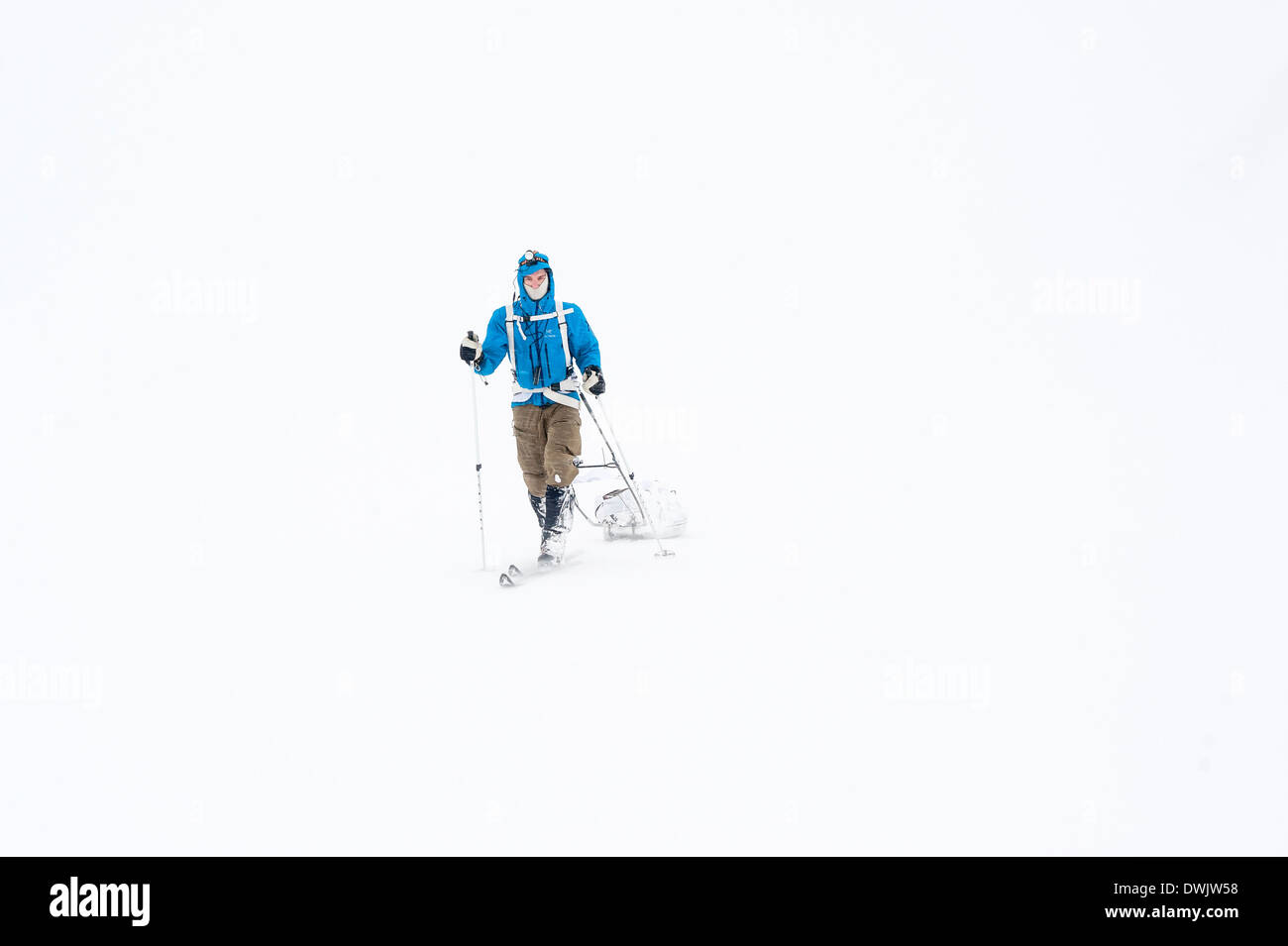 A lonesome skier in whiteout at the Hardangervidda plateau, Norway during Expedition Amundsen 2014. Stock Photo