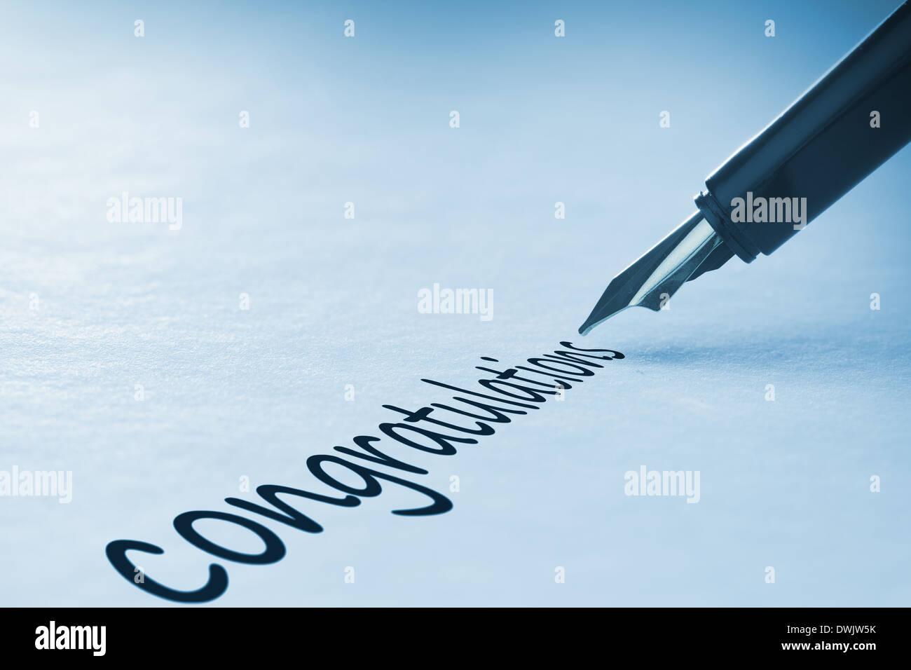 Fountain pen writing Congratulations - Stock Image
