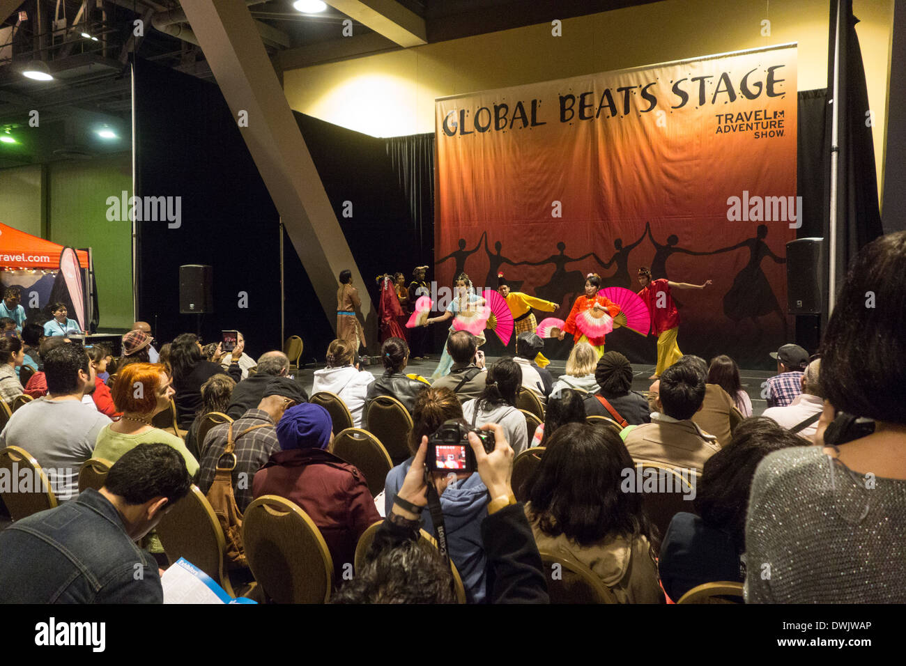 dance performance by Asian dancers in traditional dress at Travel Trade Show in Los Angeles California United States - Stock Image