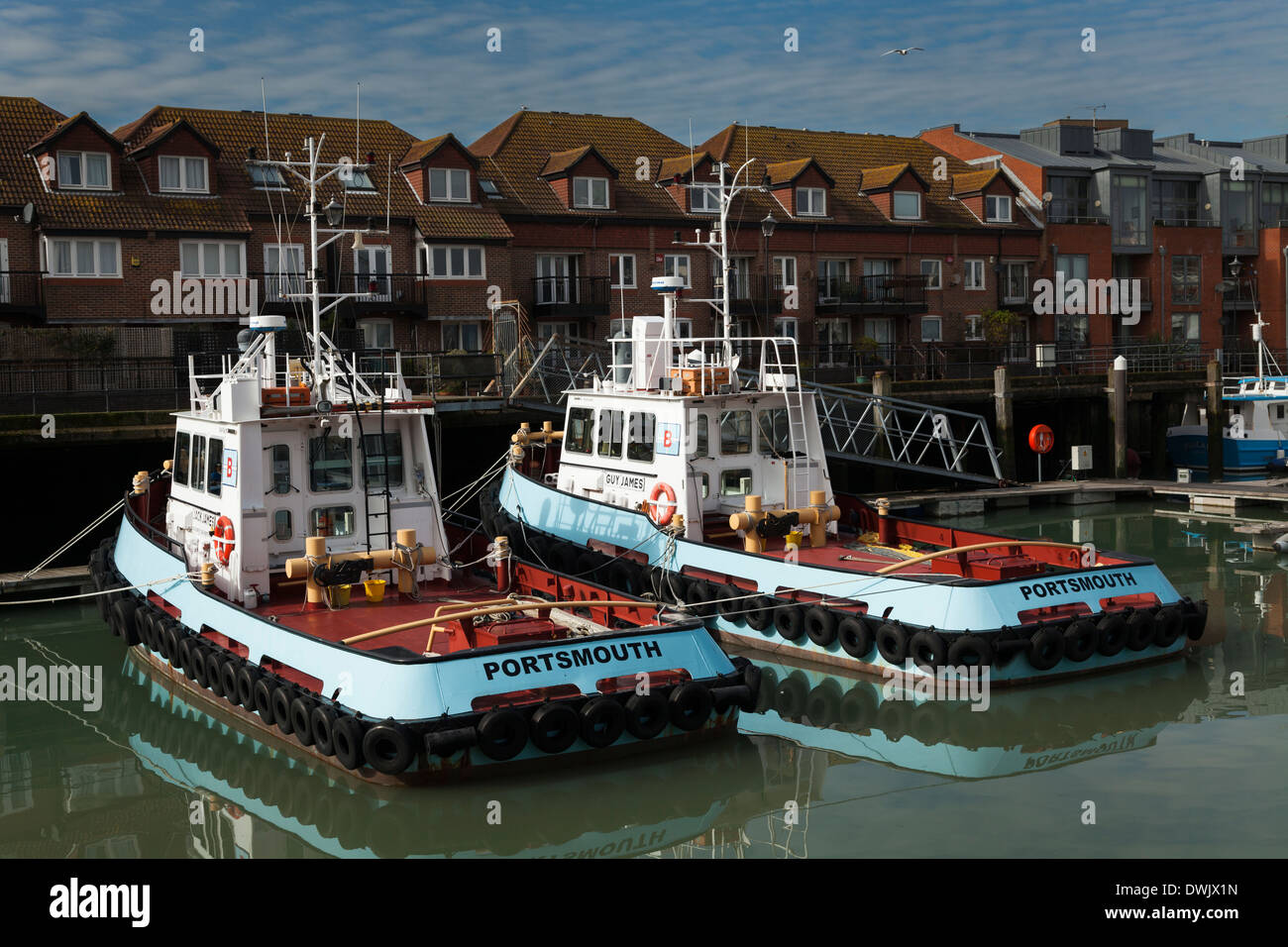 Two Portsmouth tug boats moored in the Harbour. - Stock Image