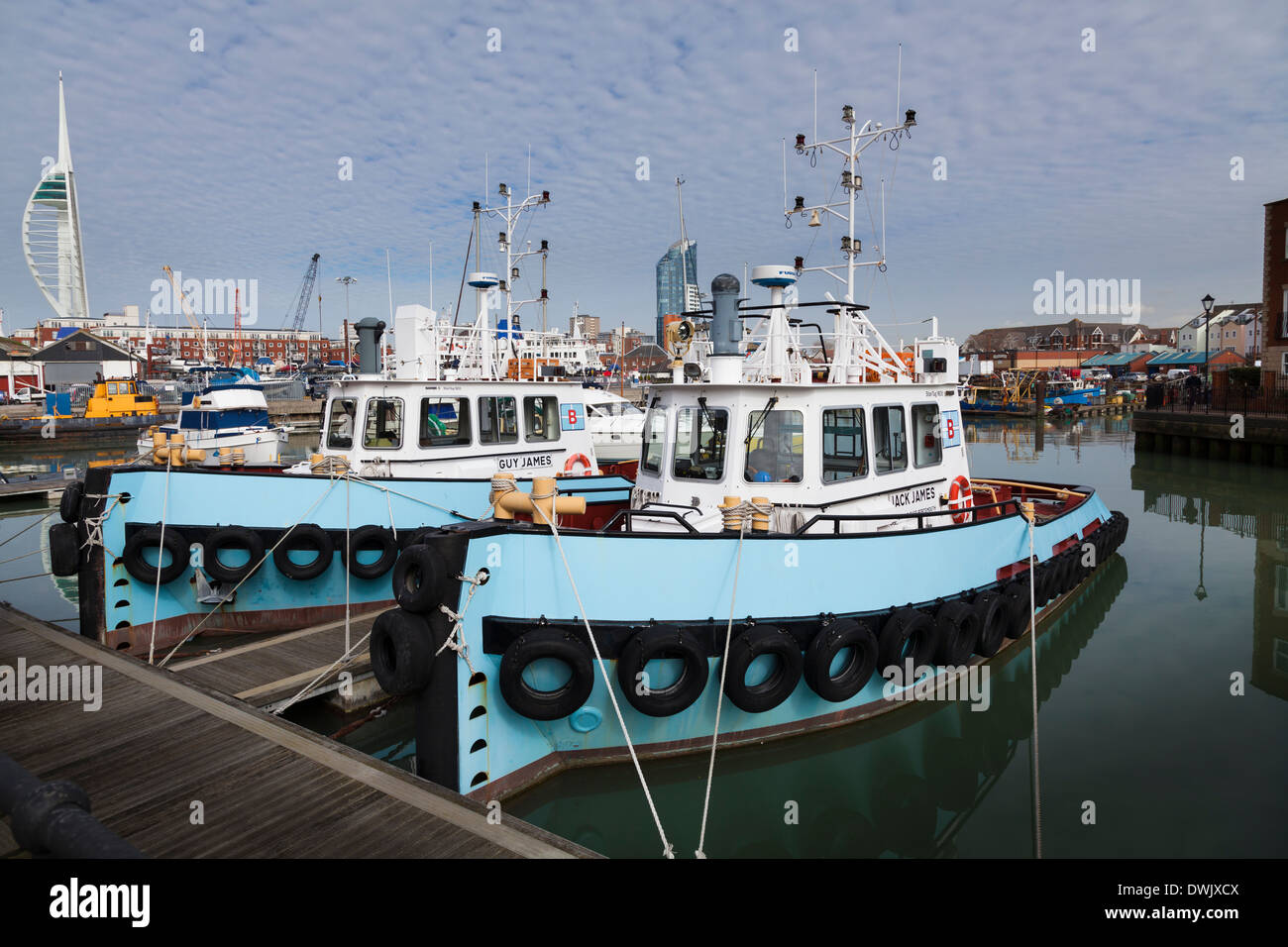 Two Portsmouth tug boats moored in Portsmouth Harbour. - Stock Image