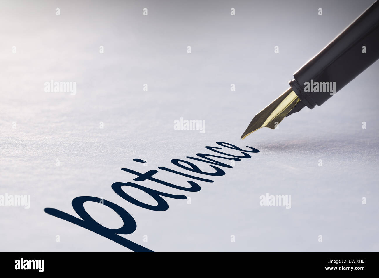 Fountain pen writing Patience - Stock Image