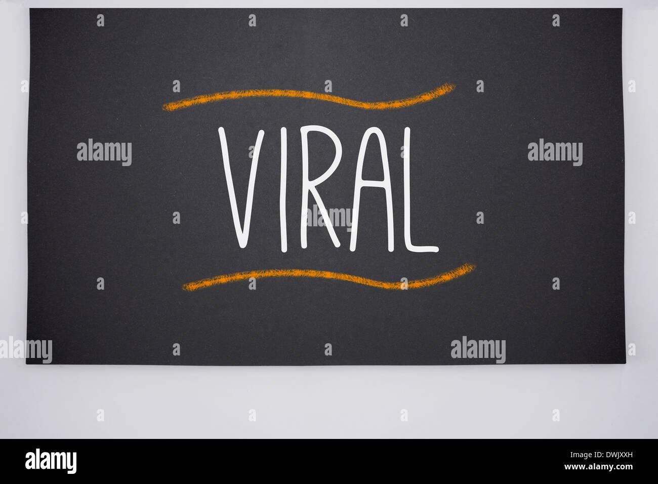 Viral written on big blackboard - Stock Image