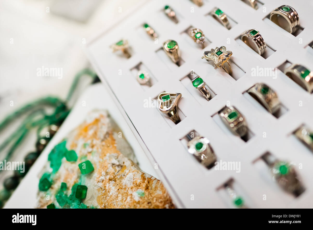 A jewelry display box, containing gold rings with emeralds, is seen in the jewelry workshop in Bogota, Colombia. - Stock Image