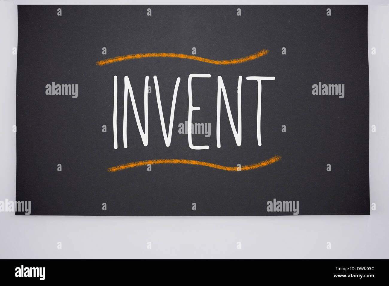 Invent written on big blackboard - Stock Image