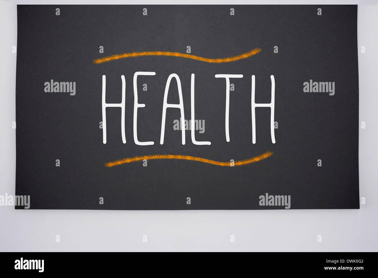 Health written on big blackboard - Stock Image