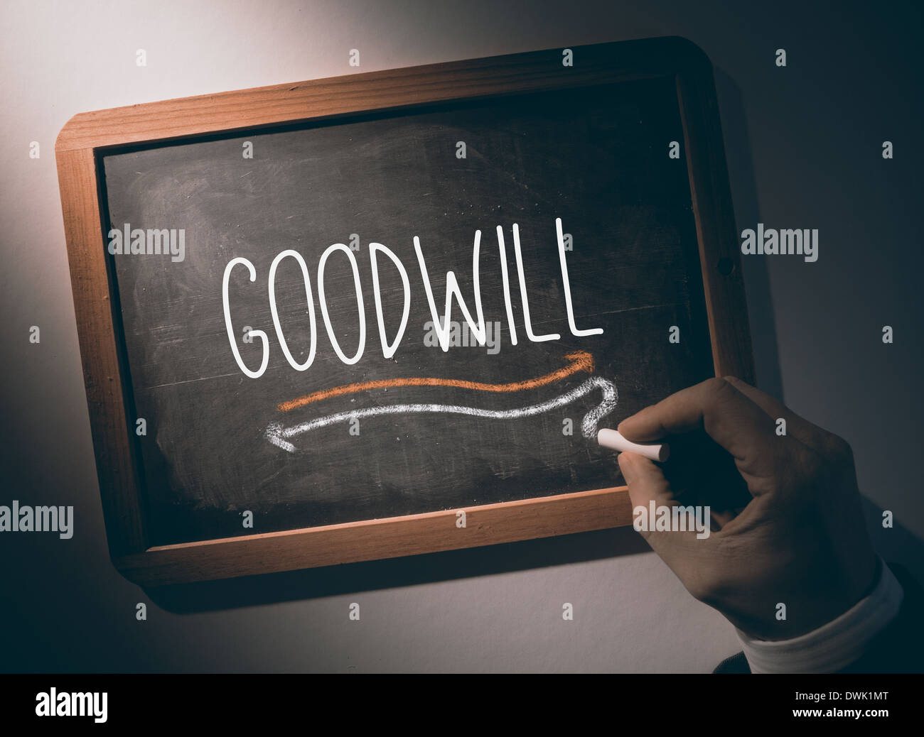 Hand writing Goodwill on chalkboard - Stock Image