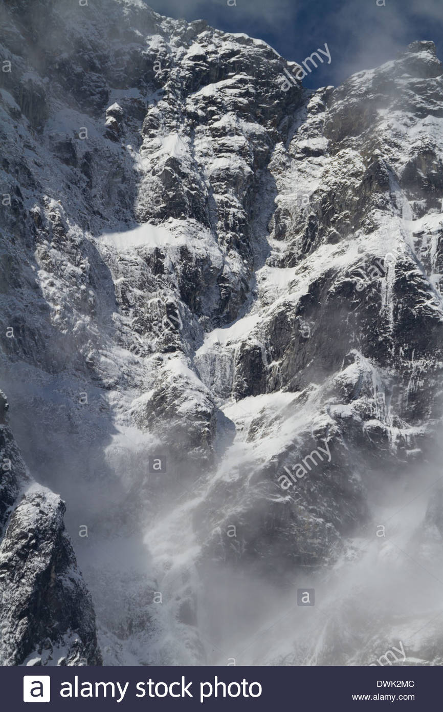 Icefalls cover the side of a mountain in the Himalayas of Nepal - Stock Image
