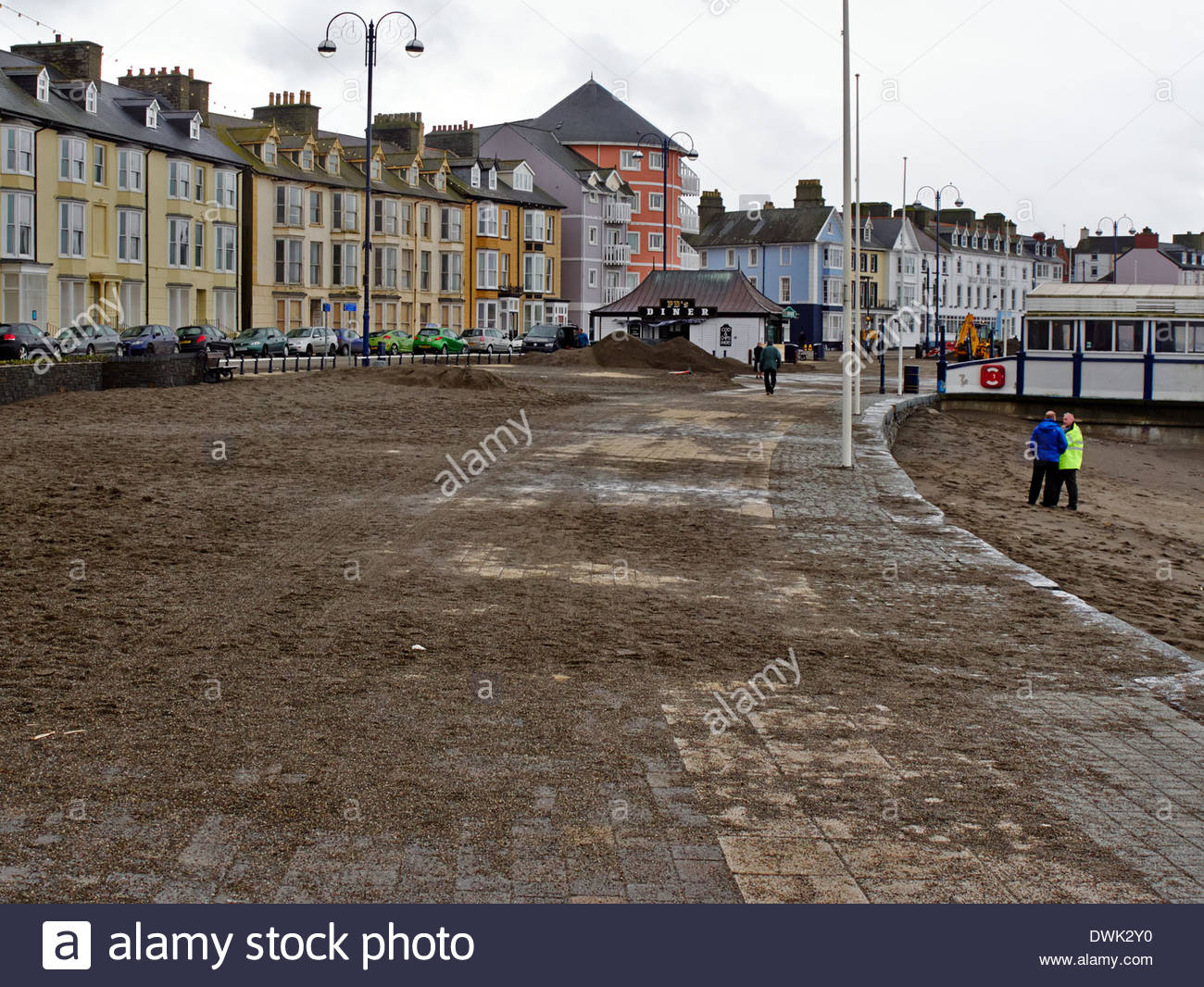 the big clean up operation begins in aberystwyth seaside after the devastating storms of 2014 Stock Photo