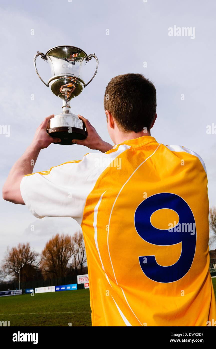 Belfast, Northern Ireland. 10 Mar 2014 - An Antrim player holds up the Cadburys Ulster Under 21 Football Championship Stock Photo
