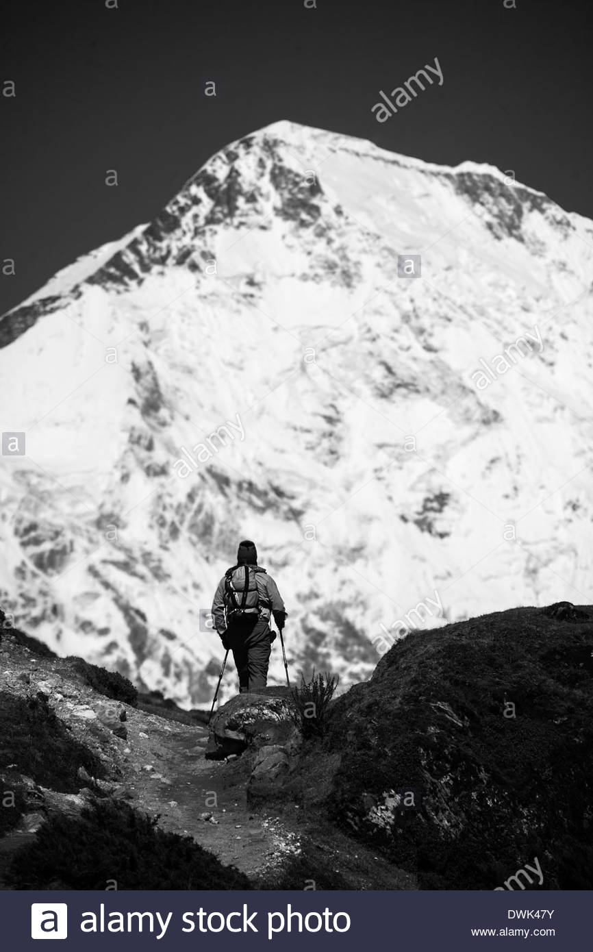 Trekker hiking in front of Mount Everest - Nepal - Solukhumbu District - Stock Image