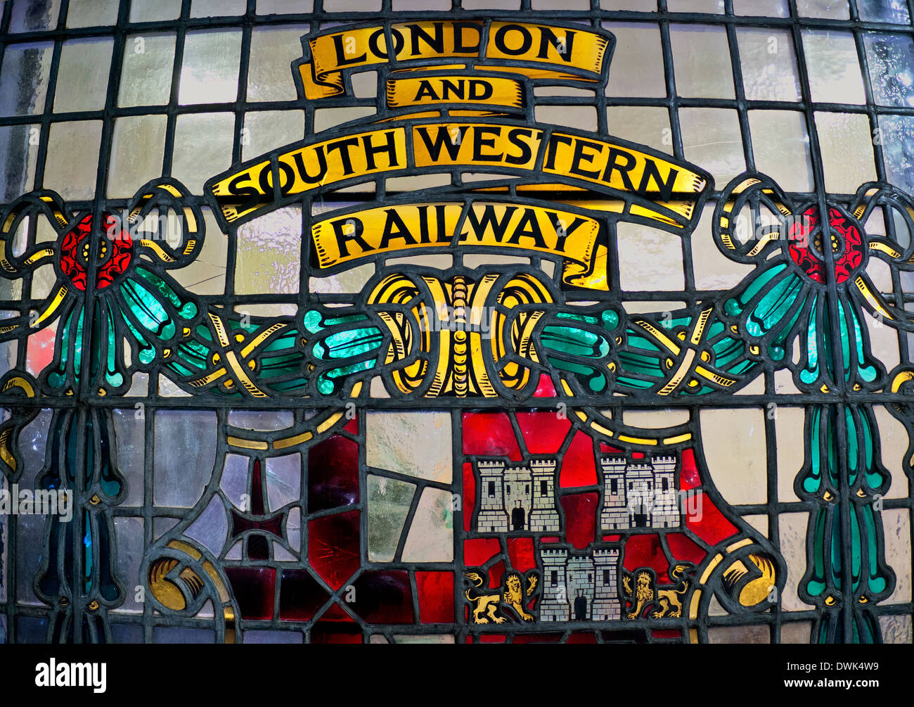 Historic stained glass window at Waterloo Station depicting former independent London and South Western Railway - Stock Image