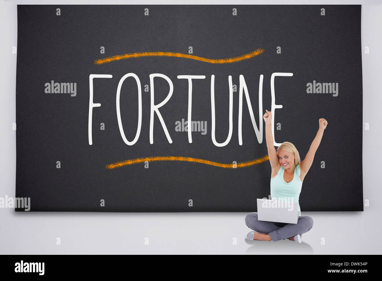 Cheering blonde with laptop against the word fortune - Stock Image