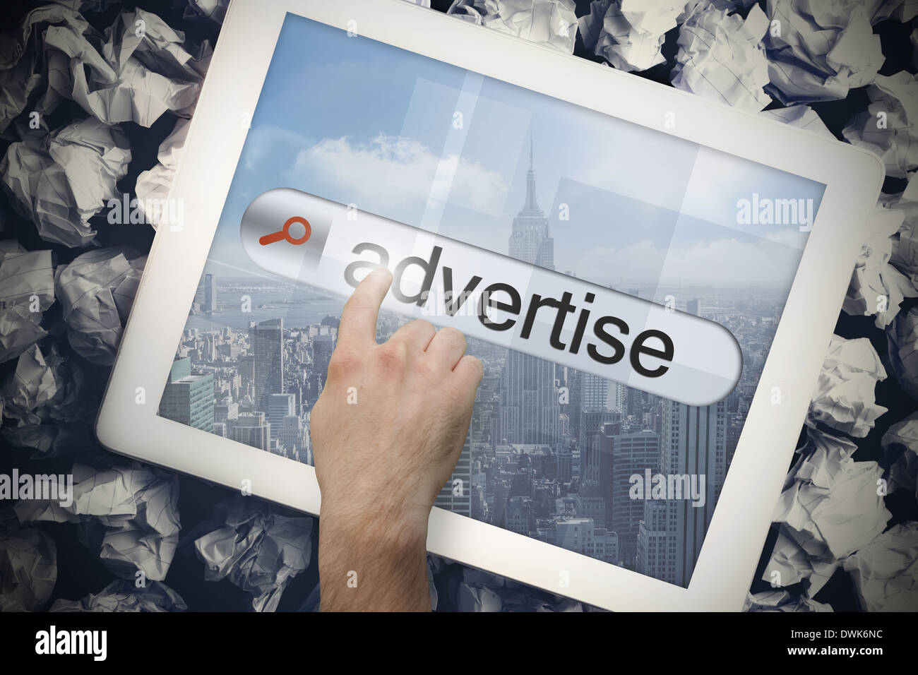 Hand touching advertise on search bar on tablet screen - Stock Image
