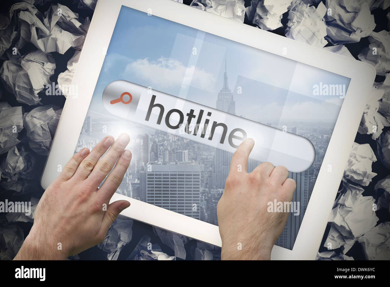 Hand touching hotline on search bar on tablet screen - Stock Image