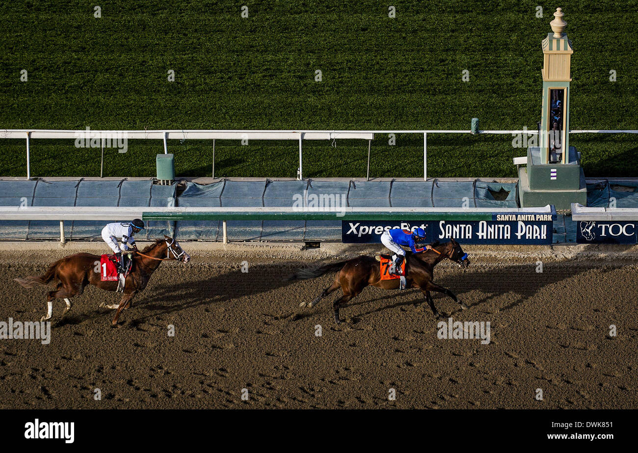 Arcadia, CA, USA. 8th Mar, 2014. Game on Dude, ridden by Mike Smith defeats Will Take Charge to win the Santa Anita Handicap (G1) at Santa Anita Park on March 8, 2014 in Arcadia, California © Alex Evers/Eclipse Sportswire/Eclipse/ZUMAPRESS.com/Alamy Live News - Stock Image