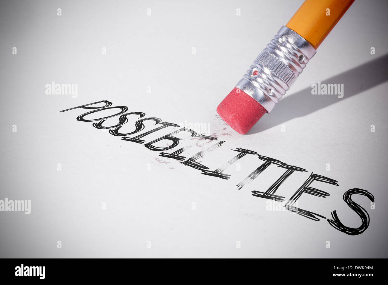 Pencil erasing the word Possibilities - Stock Image