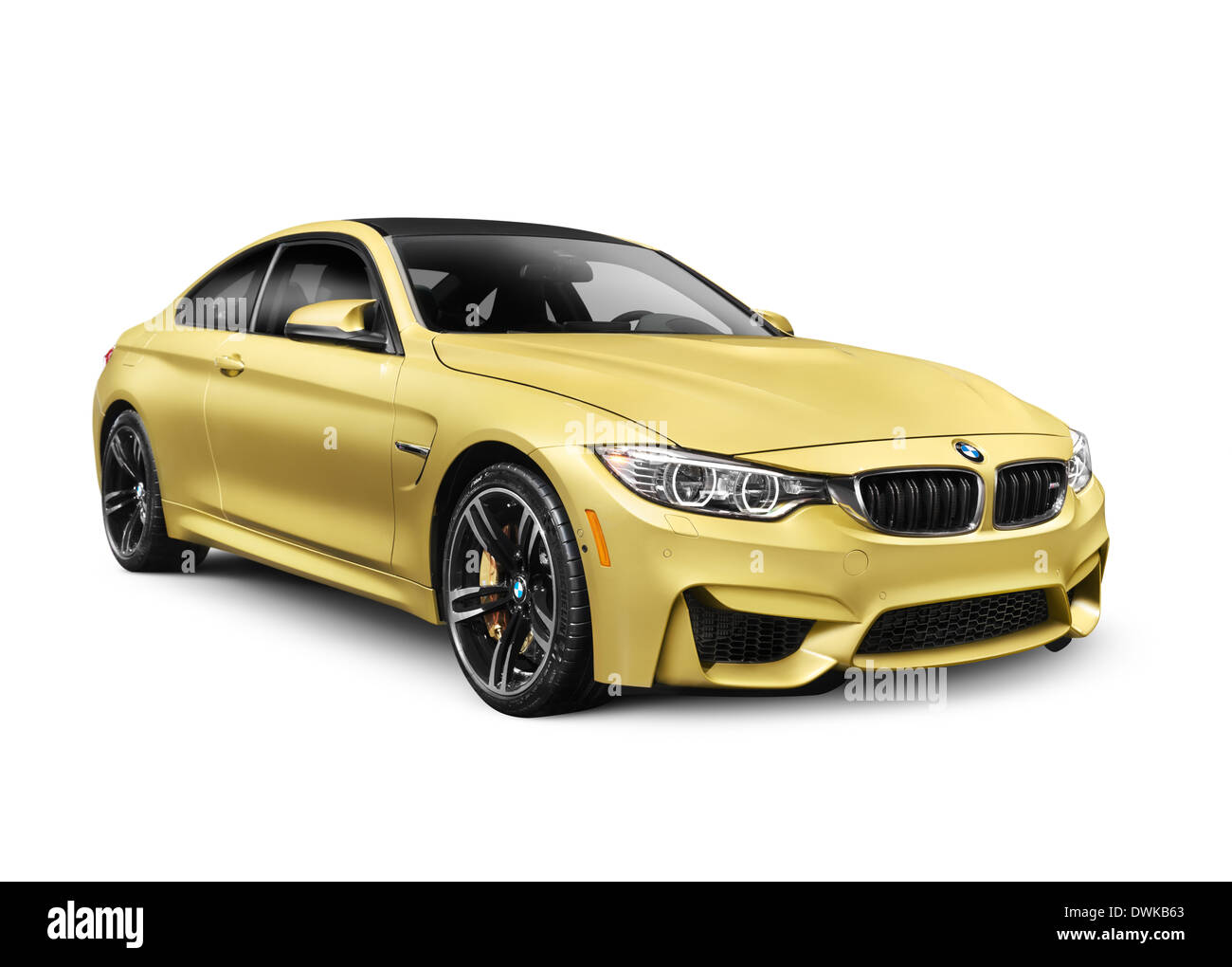 Gold 2015 BMW M4 Coupe performance car isolated on white background - Stock Image