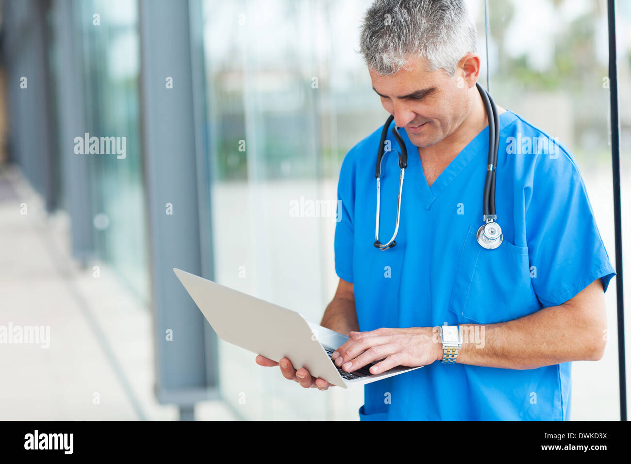 modern senior doctor working on a laptop Stock Photo