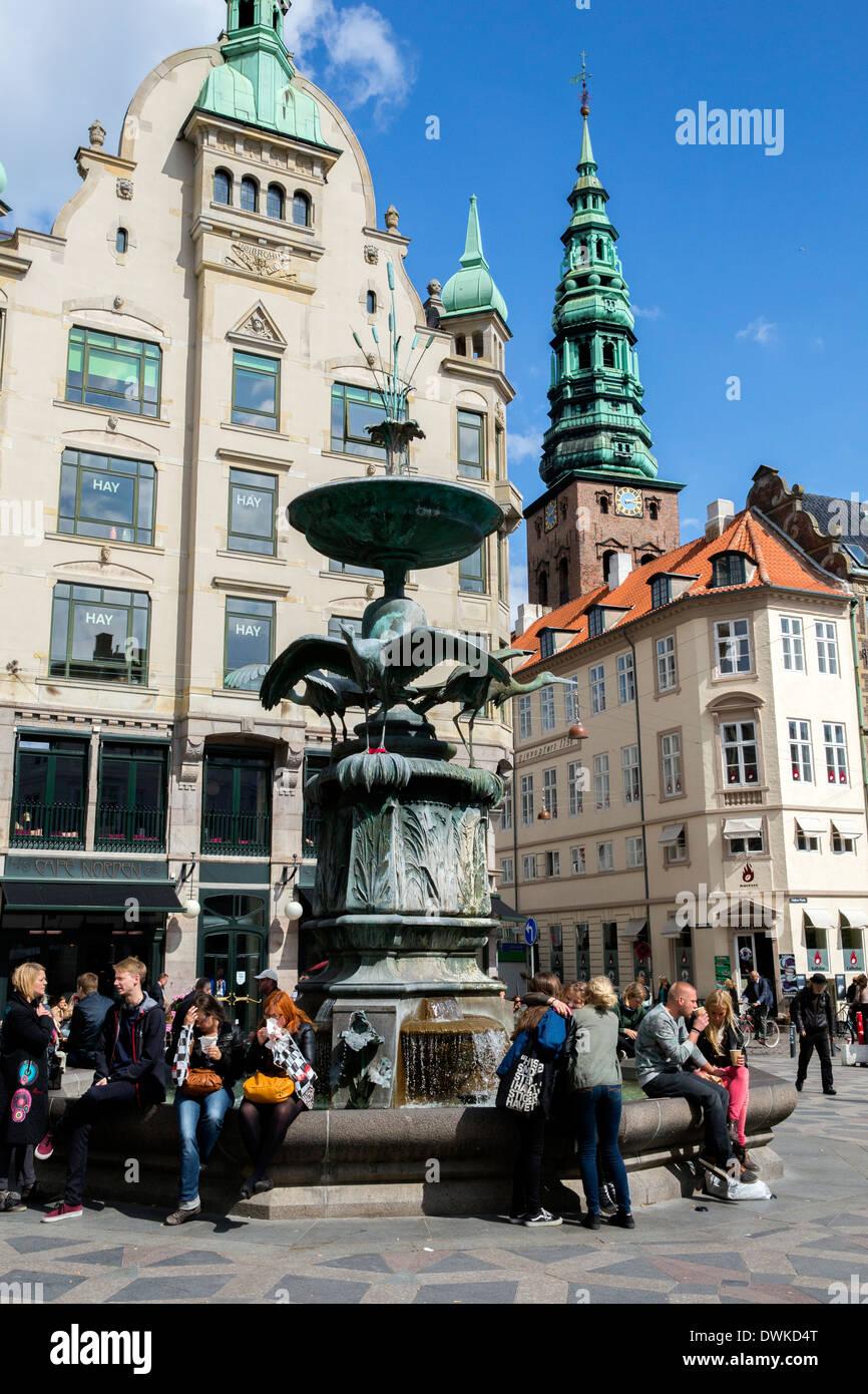 The pedestrian area around the Storkespringvandet statue in Copenhagen. - Stock Image