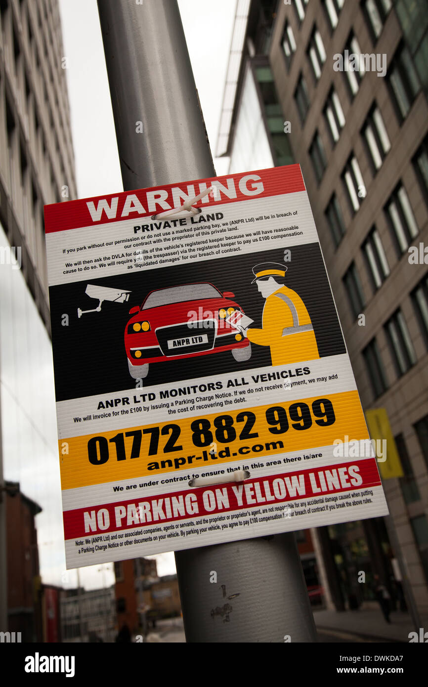 Warning private land. No parking on yellow lines, private parking enforcement in Manchester, UK - Stock Image