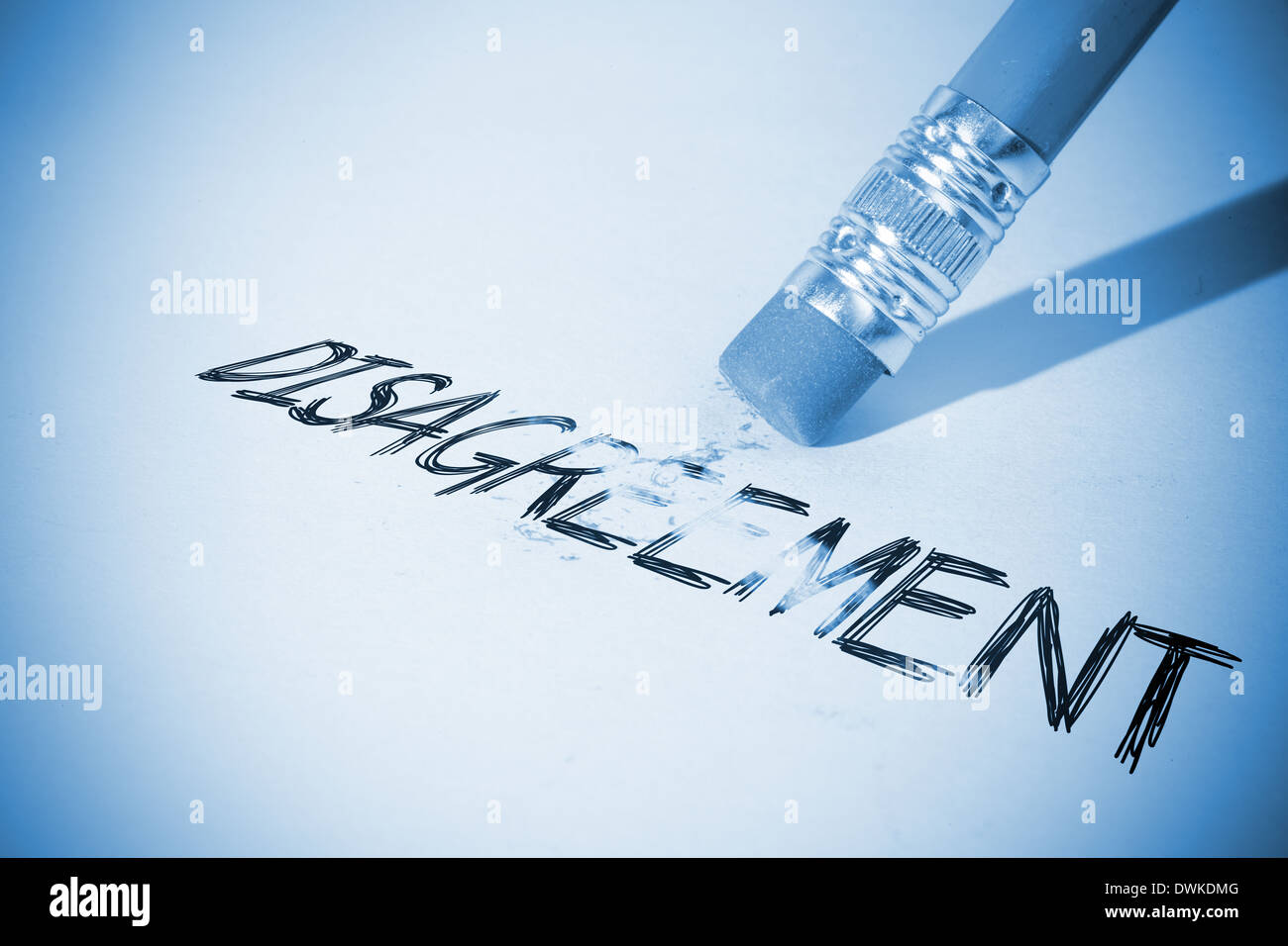 Pencil erasing the word Disagreement - Stock Image