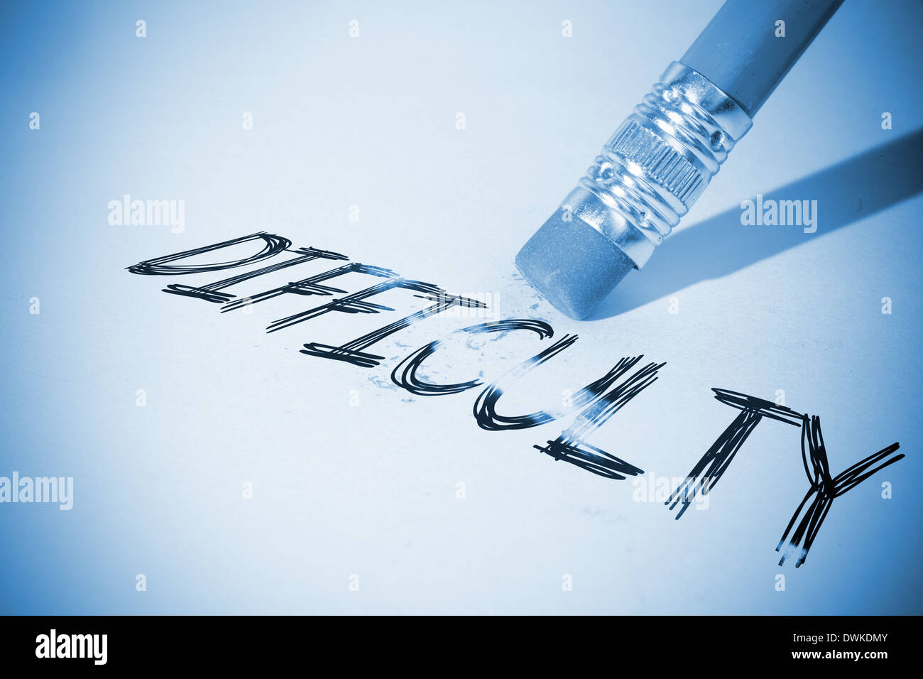 Pencil erasing the word Difficulty - Stock Image
