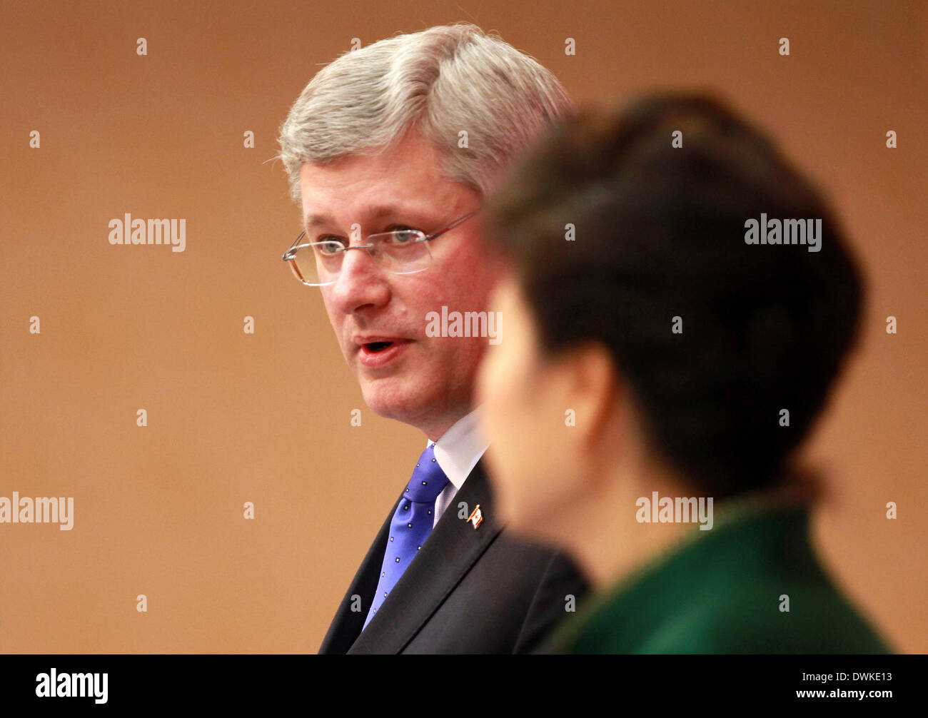 Seoul, South Korea. 11th Mar, 2014. South Korean President Park Geun-Hye (Front) and Canadian Prime Minister Stephen Harper hold a joint press conference at the presidential Blue House in Seoul, South Korea, March 11, 2014. South Korea and Canada finalized years of negotiations on their free trade agreement (FTA) on Tuesday after talks between Park Geun-hye and Stephen Harper. © Park Jin-hee/Xinhua/Alamy Live News - Stock Image