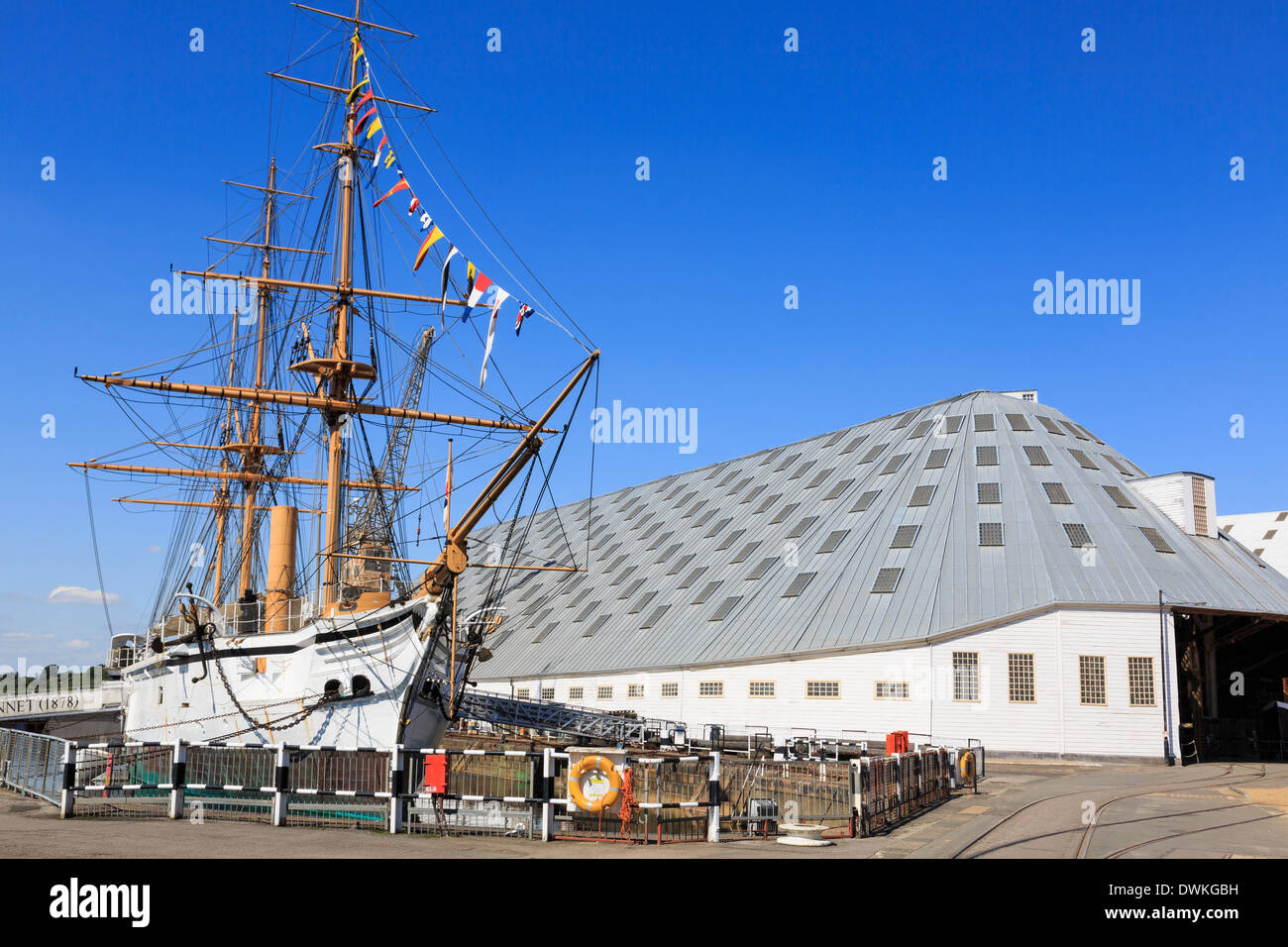 HMS Gannet with The Big Space building beyond at maritime heritage museum in Historic Dockyard at Chatham, Kent, England, UK - Stock Image